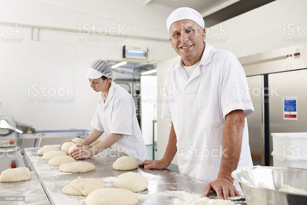 Chefs baking in kitchen stock photo