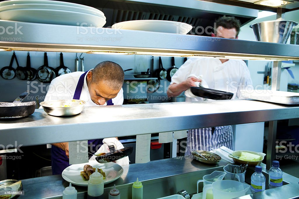 Chefs cooking dinner service in the kitchen royalty-free stock photo