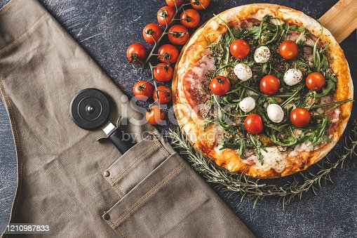 istock Chef's equipment and pizza 1210987833
