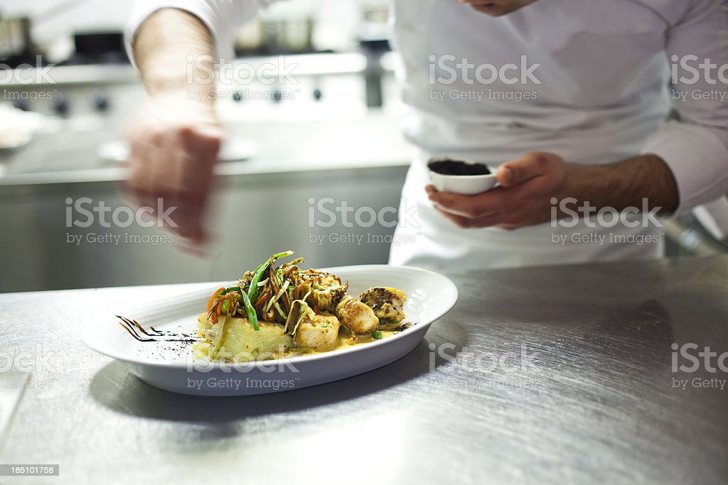 Chef's final touch stock photo