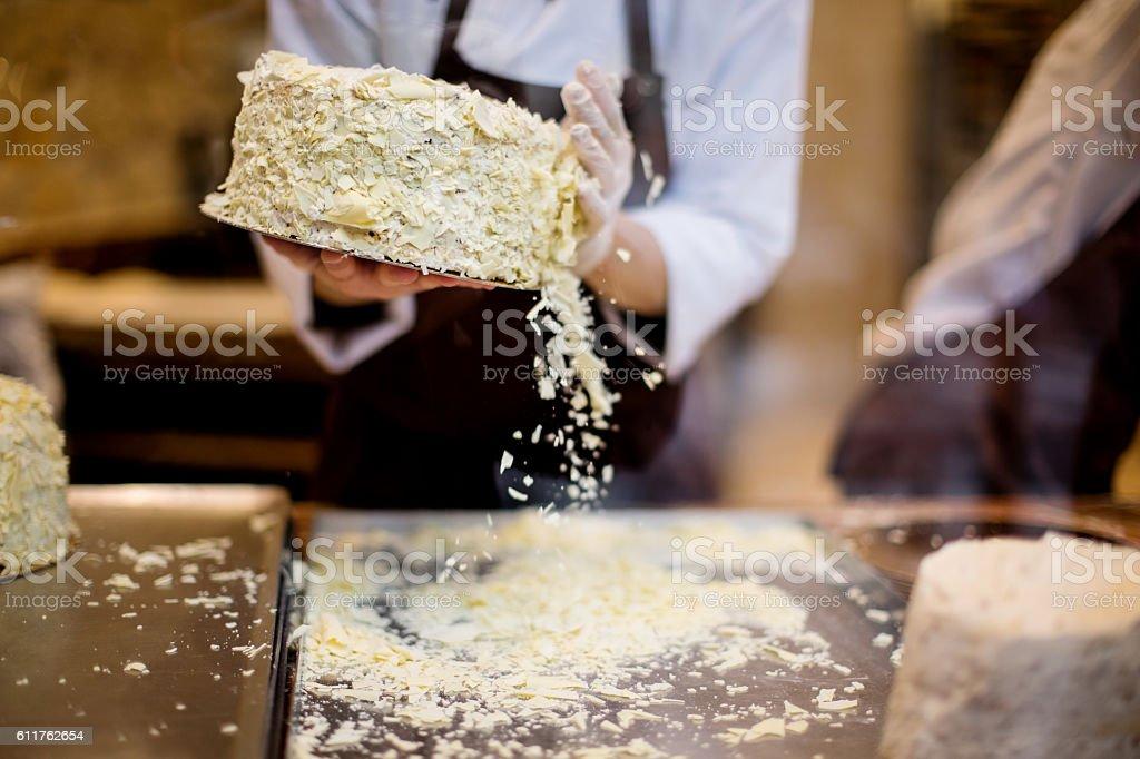 Chef's hands making cake stock photo