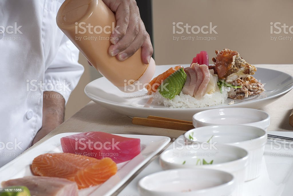 Chef's Hands Preparing an Artistic Raw Fish Plate royalty-free stock photo