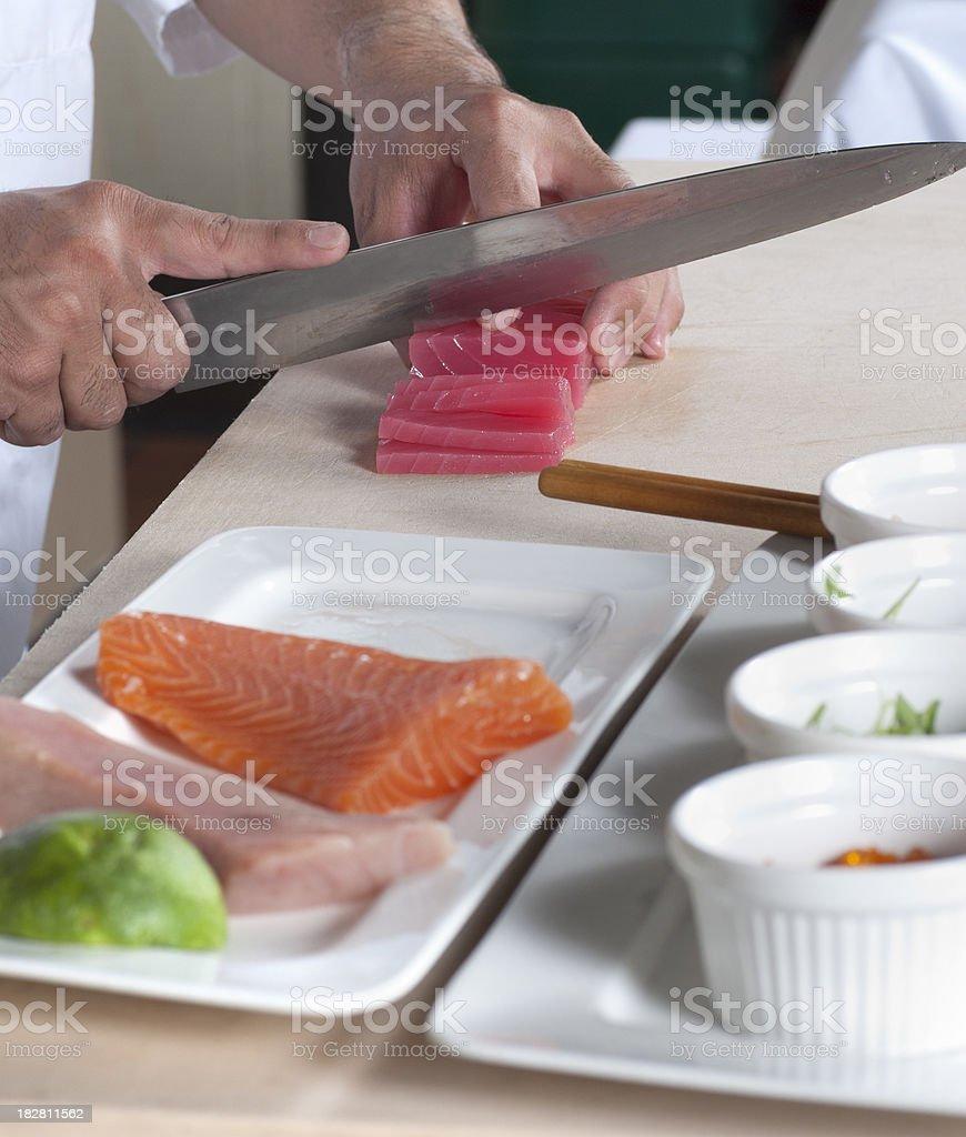 Chef's Hands Preparing Sushi royalty-free stock photo
