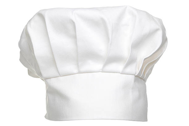 Chefs hat isolated Photo of a chefs hat traditionally called a toque blanche, isolated on a white background. chef's hat stock pictures, royalty-free photos & images