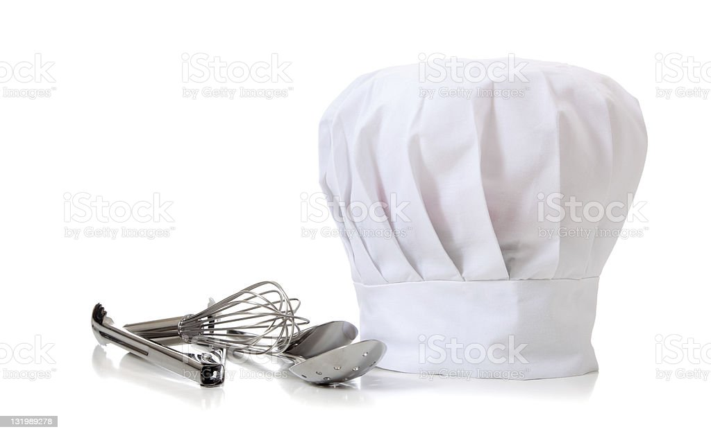 A chef's hat with a whisk and other utensils stock photo