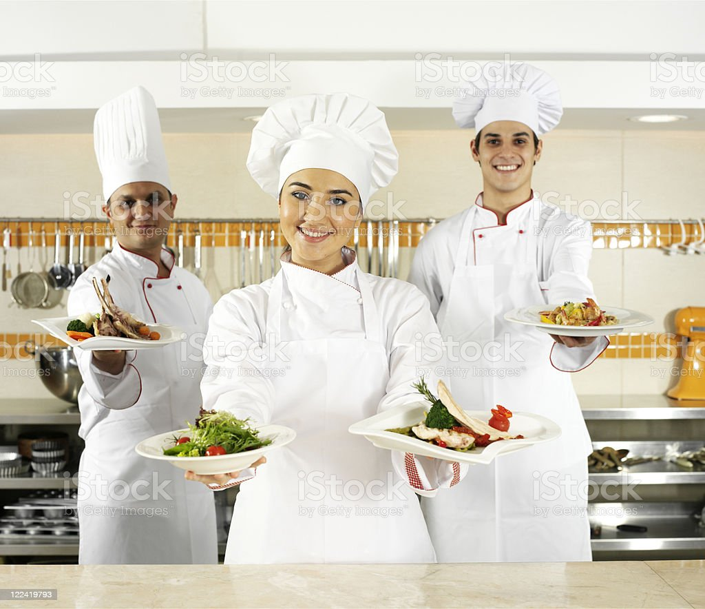 Chefs Holding Plates royalty-free stock photo