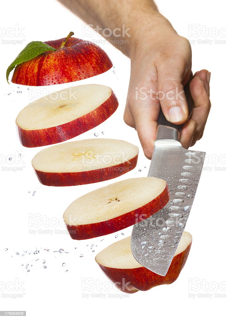Chef's Knife Slicing-Up Red Apple in Air royalty-free stock photo