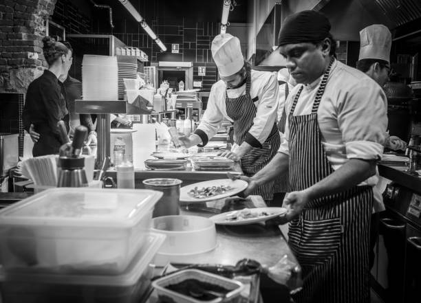chefs prepared the mail courses in the italian restaurant in milan, italy - busy restaurant kitchen stock pictures, royalty-free photos & images