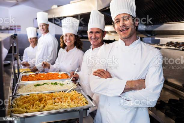 Chefs standing at serving trays of pasta picture id698589422?b=1&k=6&m=698589422&s=612x612&h=akboszmxabes wz5nkziaeq2p1vurwuc4dgg jmnscs=