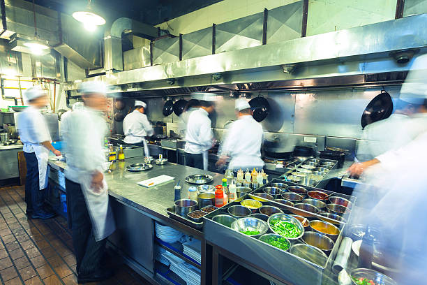 chefs working busily in chinese kitchen - busy restaurant kitchen stock pictures, royalty-free photos & images