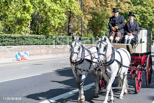 1125782554 istock photo Chelsea area street with horse tour traditional carriage in traffic closeup on road by Kensington during sunny day 1125781629