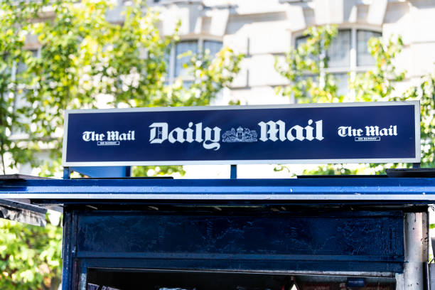 Chelsea street with closeup of sign on square for dailymail daily mail newsstand newspaper magazine stand news blue color stock photo