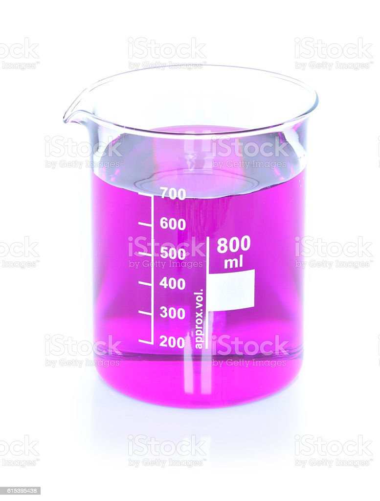 Chemical beaker with permanganate dissolved in water stock photo