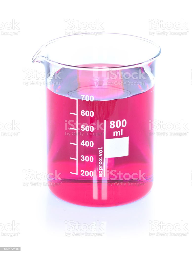 Chemical beaker with red chemicals dissolved in water stock photo