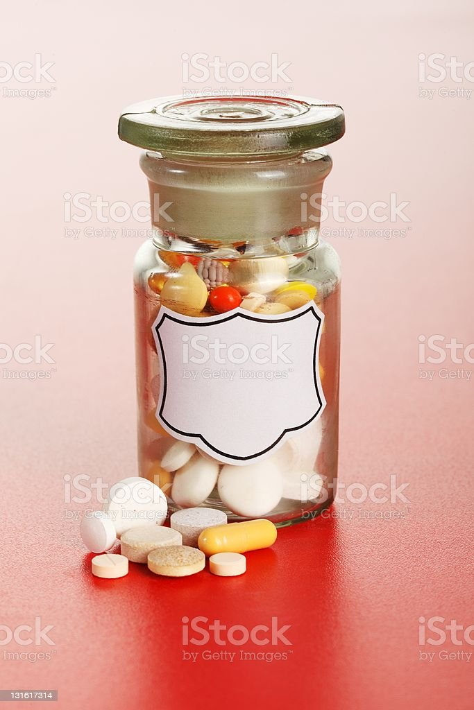 Chemical bottle with colorful pills royalty-free stock photo