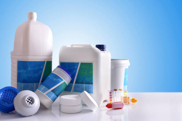 Chemical cleaning products for pool with blue background - foto de stock