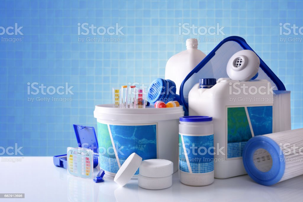 Chemical cleaning products for pool with blue mosaic background overview stock photo
