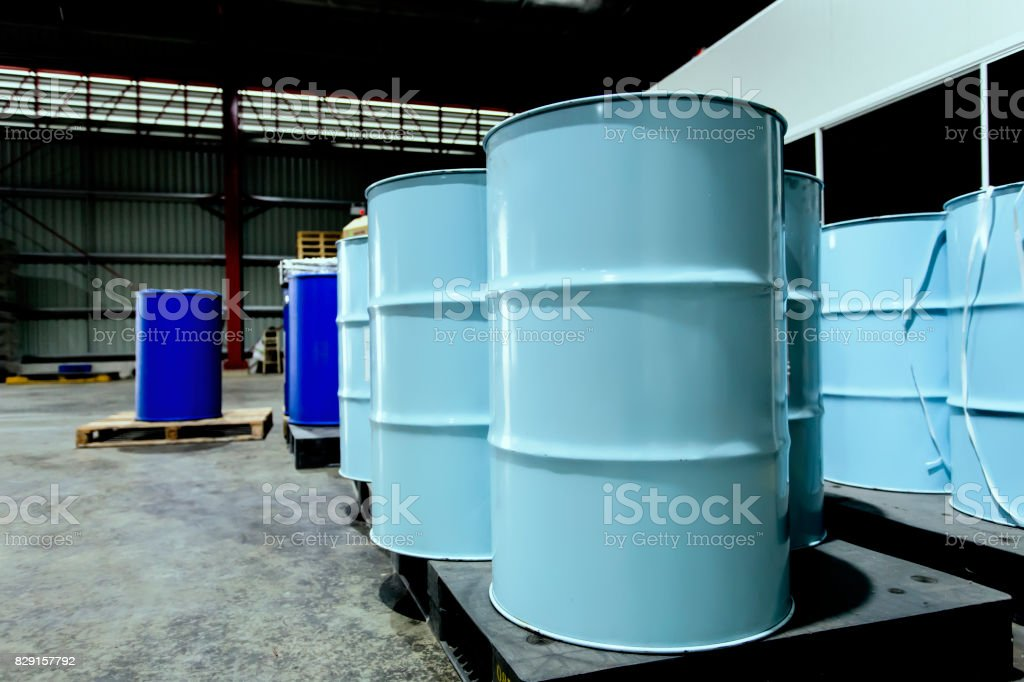 Chemical containment 200 liters tanks stored in chemical storage area in the factory warehouse. Can be use as background of any content about chemical in the factory. stock photo