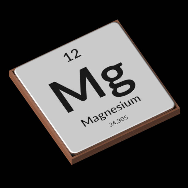 chemical element magnesium embossed metal plate on a black background - magnesium stock photos and pictures