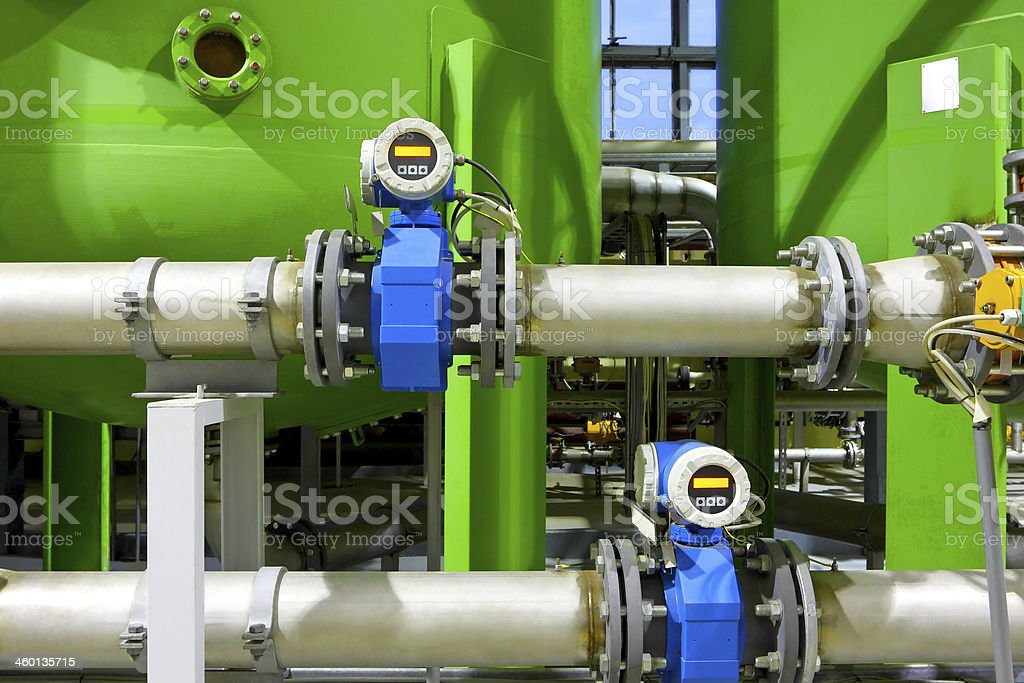 A chemical factory with huge tanks and pipes stock photo
