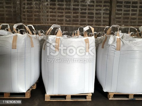 Chemical fertilizer Urea Stock pile jumbo-bag in warehouse waiting for shipment.