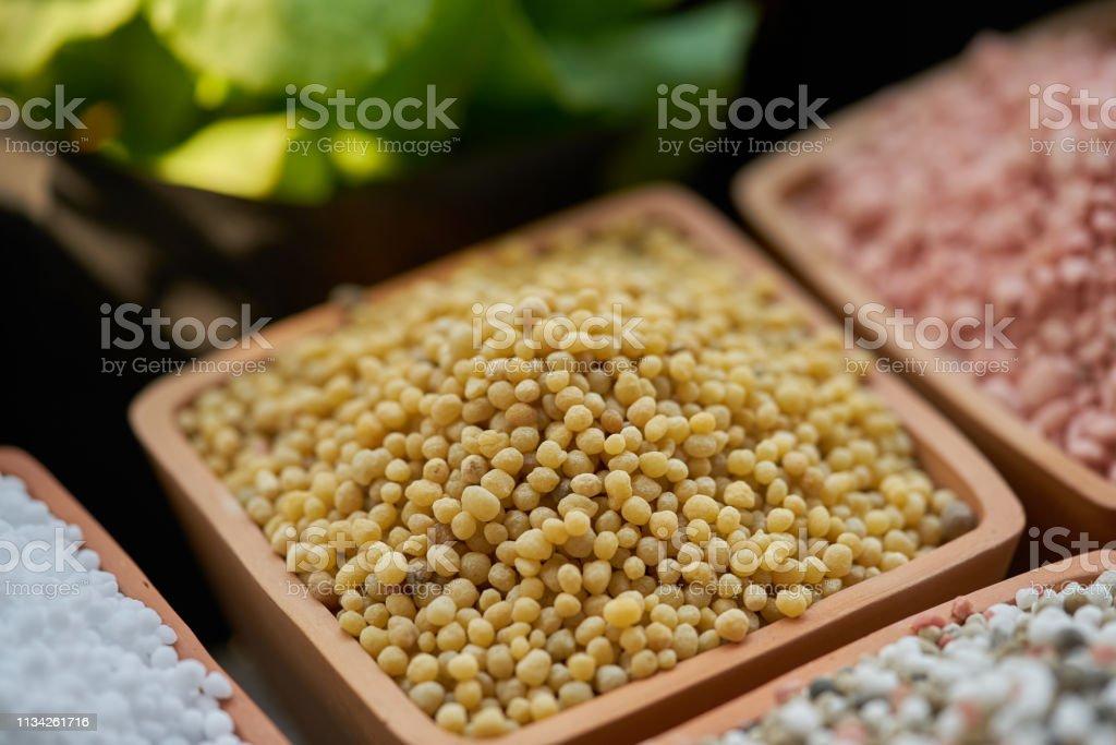 NPK, chemical fertilizers in clay pots stock photo