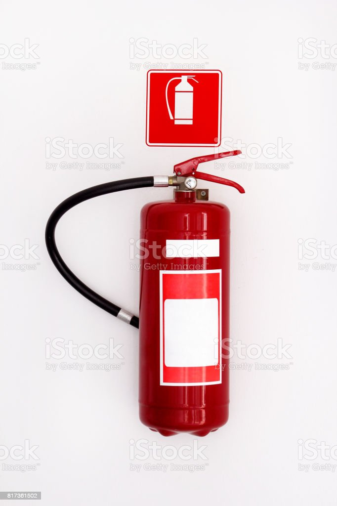 Chemical fire extinguisher isolated on a white wall background, with clipping path. stock photo