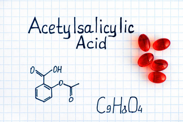 Chemical formula of Acetylsalicylic Acid with red pills. Chemical formula of Acetylsalicylic Acid with red pills. Close-up. acetylsalicylic stock pictures, royalty-free photos & images