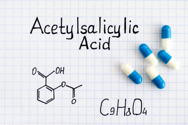 Chemical formula of Acetylsalicylic Acid with some pills. Chemical formula of Acetylsalicylic Acid with some pills. Close-up. acetylsalicylic stock pictures, royalty-free photos & images