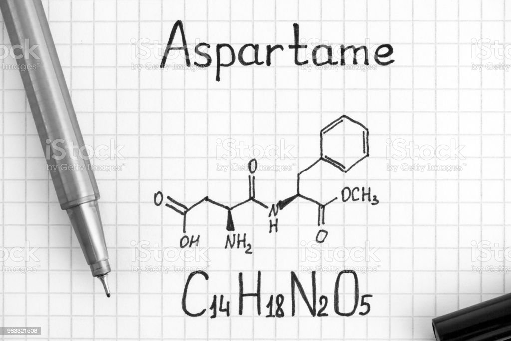 Chemical formula of Aspartame with black pen. stock photo