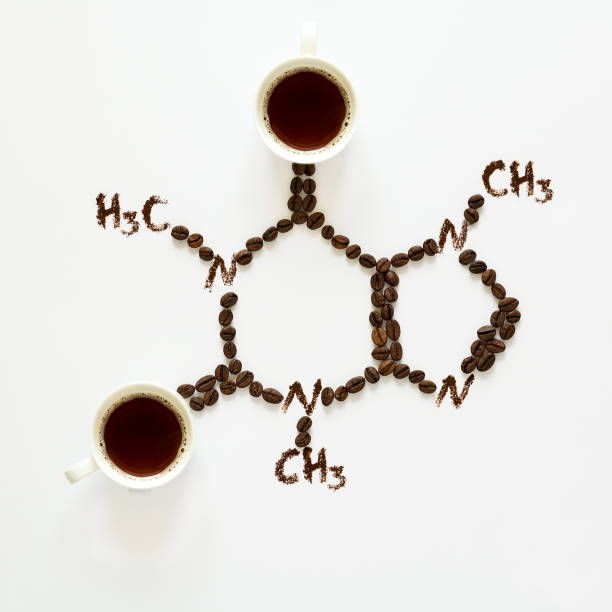 Chemical formula of Caffeine. Cups of espresso, beans and coffee powder. Art food. Top view. Chemical formula of Caffeine. Cups of espresso, beans and coffee powder. Art food. Top view. caffeine stock pictures, royalty-free photos & images