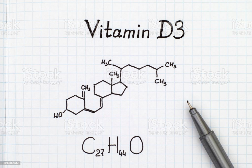 Chemical formula of Vitamin D3 with black pen. stock photo