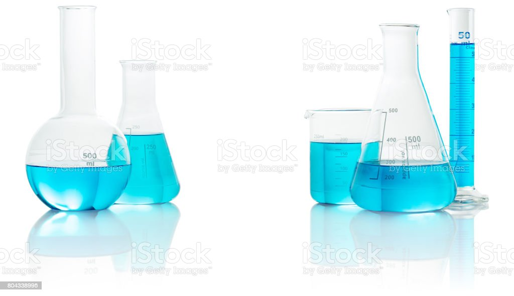 chemical glassware with blue liquid stock photo