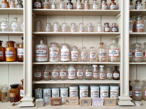 Chemical jars in old pharmacy stock photo