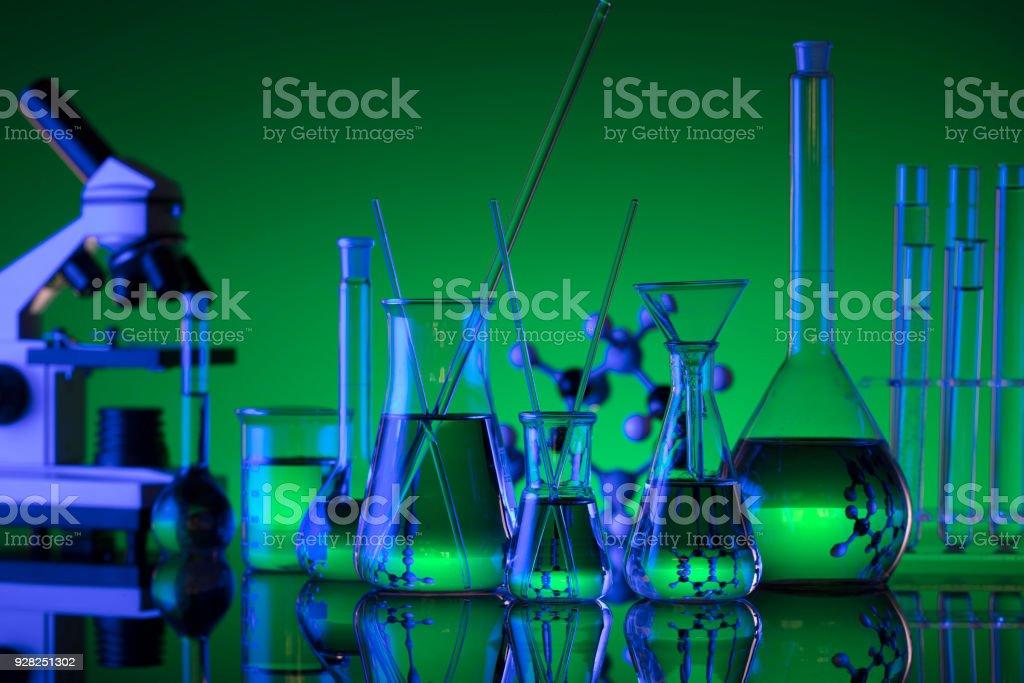 chemical laboratory concept, beakers, microscope