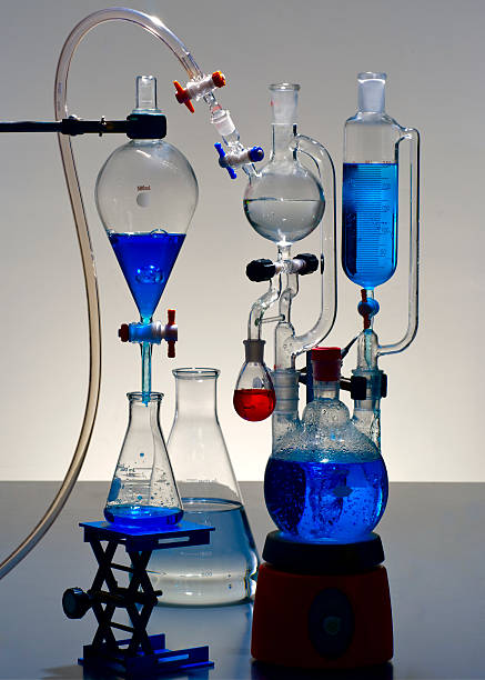 Chemical Laboratory Glassware with Blue Solutions stock photo