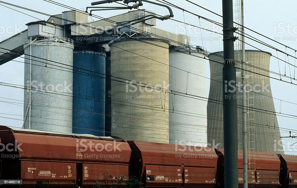 Chemical plant and red train royalty-free stock photo