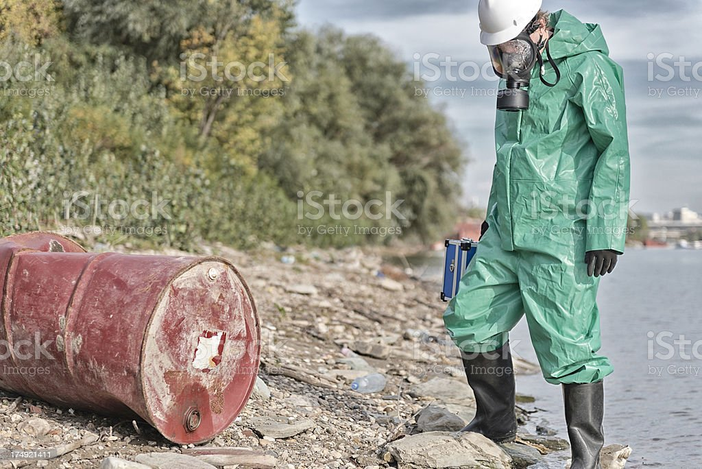 Chemical pollution relief worker stock photo