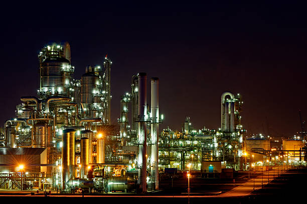 Chemical production facility at night stock photo