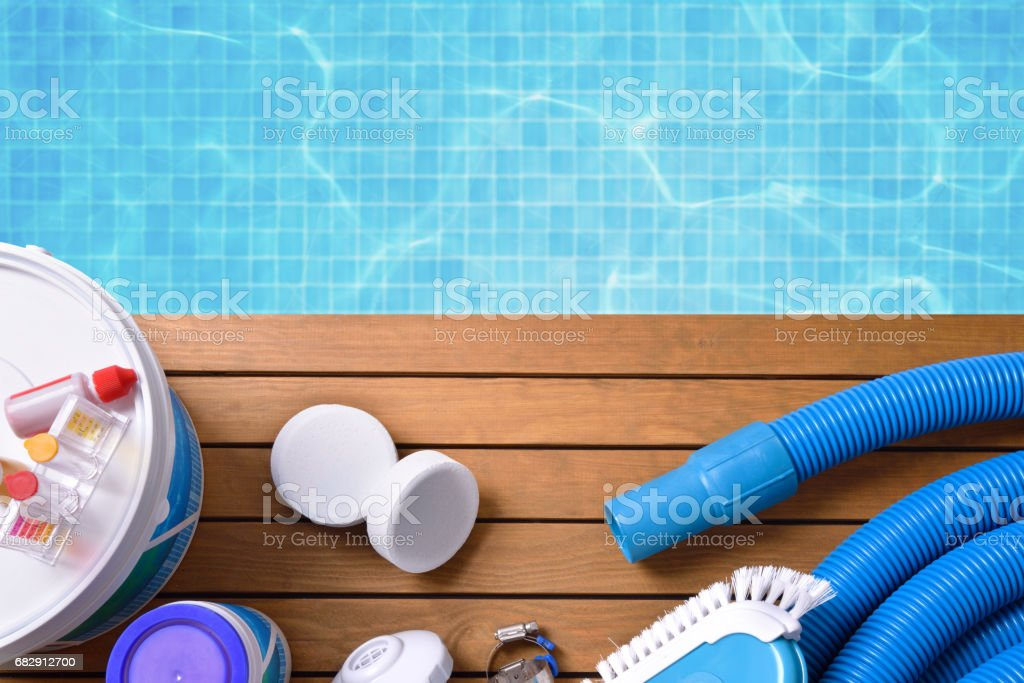 Chemical products and tools for pool maintenance stock photo