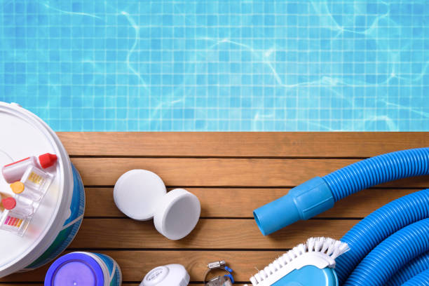 Chemical products and tools for pool maintenance - foto de stock