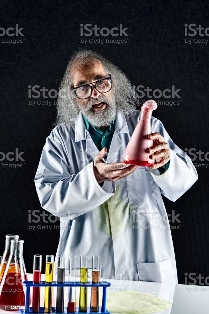 Mad scientist with a chemical reaction experiment.