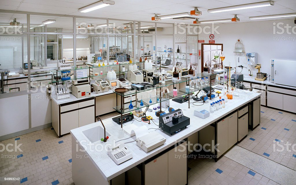 Chemical research laboratory with many instruments on the tables stock photo