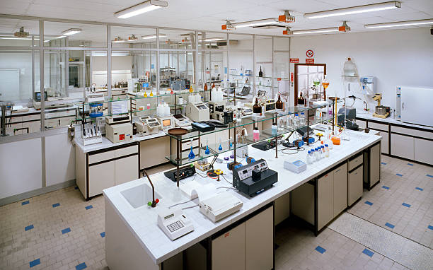 chemical research laboratory with many instruments on the tables - laboratory equipment stock photos and pictures