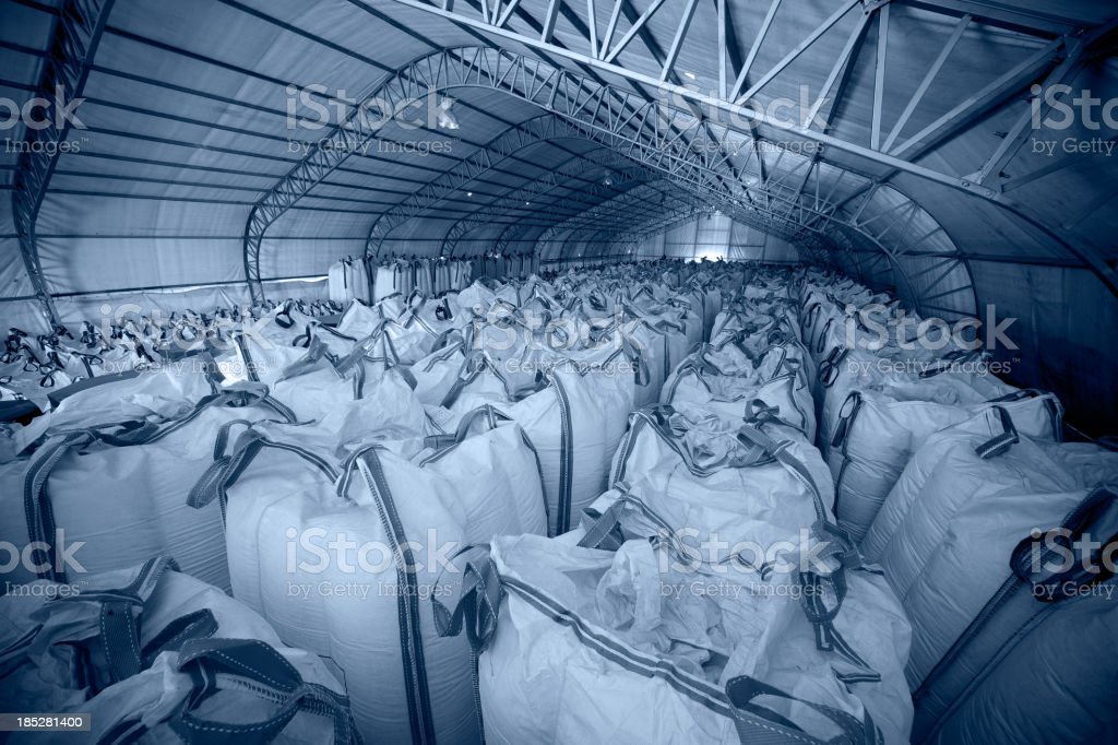 Chemical sacks and building feature royalty-free stock photo