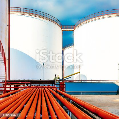 Chemical storage tanks and red pipelines