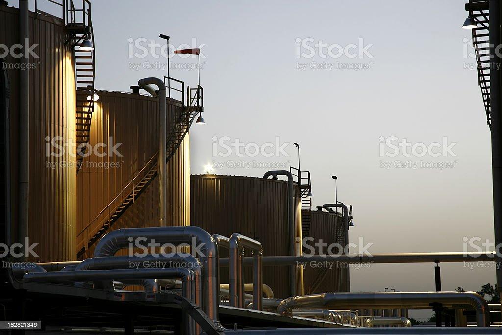 Chemical Storage Tanks at Dusk stock photo