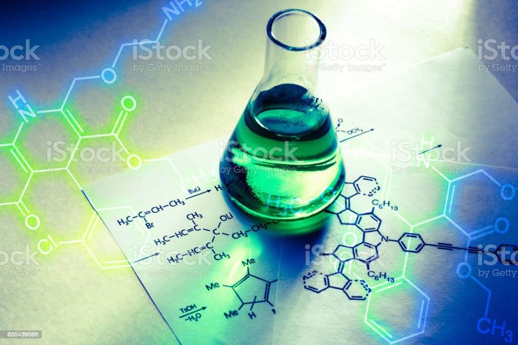 Chemical tube with reaction formula stock photo