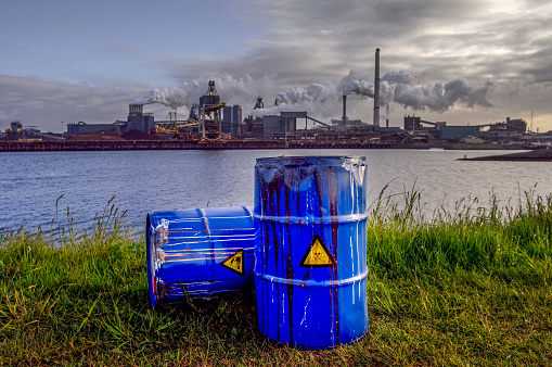 Chemical Waste Drums In Front Of Heavy Industry Stock Photo - Download Image Now