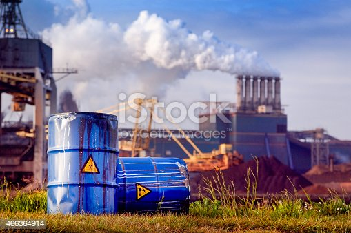 istock chemical waste drums in front of heavy industry 466364914
